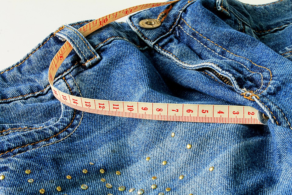 women's jeans and a tape measure for the tummy