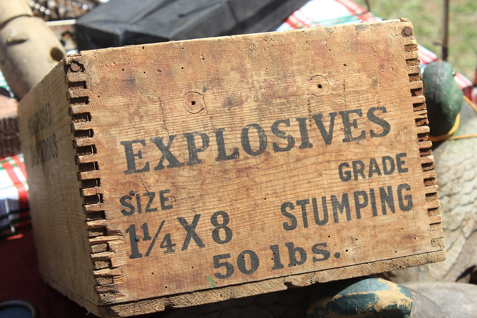 a wooden box of stumping explosives to illustrate dynamiting self-deception