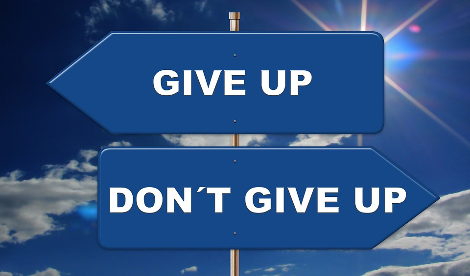 a sign of give up-don't give up to highlight the choice needed to Be Patient and Win